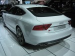 The 2013 Audi S7 Sportsback rear sports the S badge as well as four exhaust tips.
