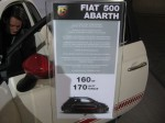 2012 Fiat 500 Abarth information card. The big news is the 1.4L Multiair turbo engine witha healthy 160 hp and 170 lb-ft torque. It won't beat the MINI Cooper S, but it has its own style.