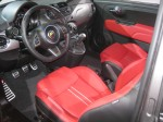 I like the red leather sports seats in this 2012 Fiat 500 Abarth.