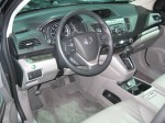 The 2012 Honda CR-V's cabin is well ordered, with clear gauges and easy to use controls. The navigation screen looks like a bit of a reach for the driver. The two-tone scheme looks good too.