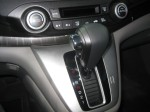 The Honda CR-V's shifter looks nice and this model has automatic climate control.