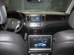 The interior of the 2012 Hyundai Equus is luxurious and the rear occupants are pampered with their own power seats, a foot rest, individual climate controls and the large flat screen shown here.