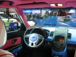 This is the interior of the Michelle Wie Kia Soul. If you thought the outside was a dream for a 10 year old girl, the inside will seal the deal. In back, it had two custom golf bags that match the pink and blue cartoon theme.