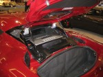 "2012 Lotus Evora engine bay and ""trunk.""  Pack light - you there isn't much cargo space in these tiny sports cars."