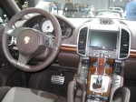 Driver's cockpit and dash of the 2012 Porsche Cayenne S.  It's really a lovely cabin and it's no wonder that Porsche can't keep up with demand. If you have to have a big, heavy SUV, the Porsche is the one to pick.