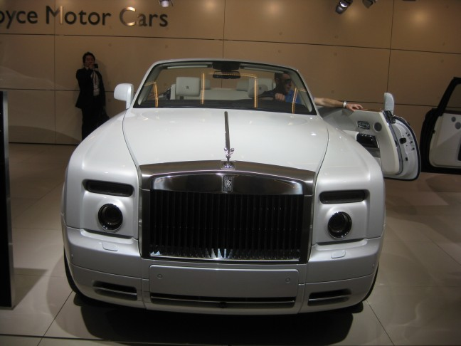 The 2012 Rolls Royce Phantom Drophead Coupe is just amazing. It's gigantic,  yet graceful. If you have to ask how much (at least $500k) you probably can't afford it.