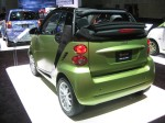2012 Smart ForTwo Cabriolet. The lime green works on this tiny car, but not many others.