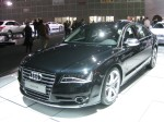 The 2013 Audi S8 ditches the Lamborghini V10 in favor of an all-new Audi 4.0L TSFI V8 engine with a twin scroll turbo making 520 hp and 479 lb-ft torque. It's limited to 155 mph.