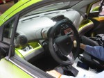 The 2013 Chevy Spark has an interesting interior that doesn't look too cheap. The color matched interior is a nice touch in this lime green version.