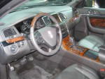 The interior of the 2013 Lincoln MKS is better, but you can still see a Taurus there. I think the wood looks fake.