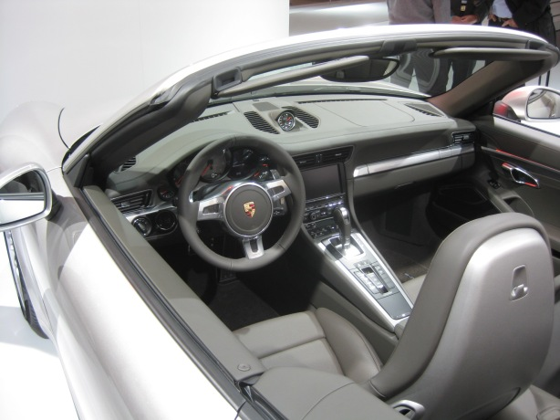 "Except for a special torque split gauge, in the instrument panel, the interior of the 911 Carrera 4S is the same as the ""regular"" 911 Carrera."