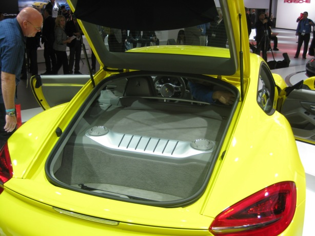 That big lump in the back of the 2013 Cayman S is the engine cover. Like the Boxster, the Cayman has a mid-mount engine which makes it the best handling Porsche. Just don't say that to the Germans at the show as they will always tell you that the 911 is the best. All the car magazines say otherwise.