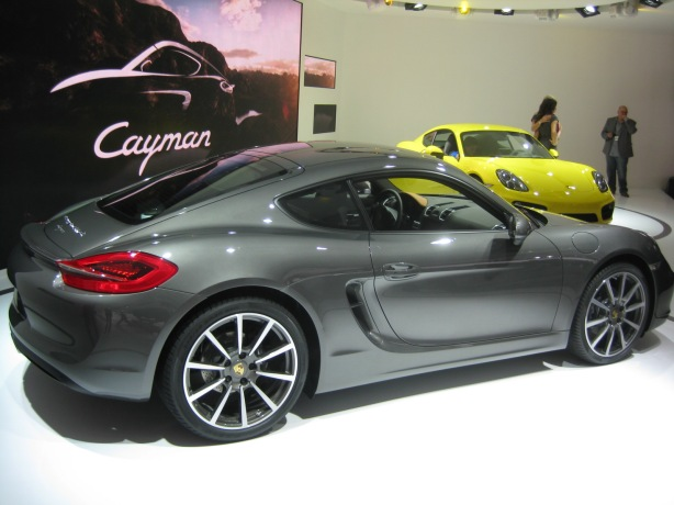 The side scoops that are accentuated with the deep creases in Cayman's door sheet metal, is how the engine breathes.