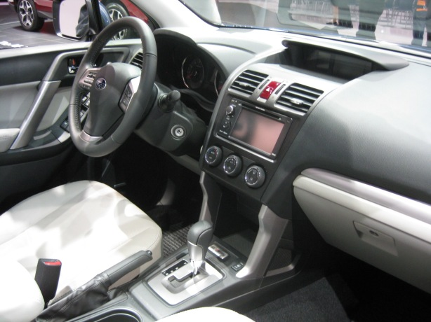 The interior of the 2014 Subaru Forester is mostly lifted from the Impreza. The infotainment system is easy to use, but lags behind the competition.
