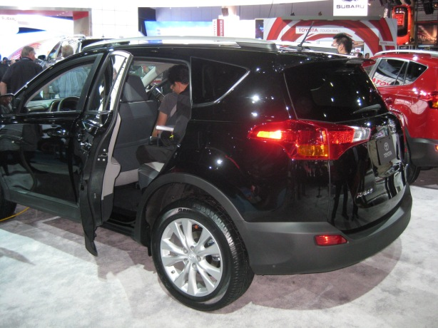 2013 Toyota RAV4 side-rear. Note that the spare tire has moved from the rear door to under the cargo floor. The rear tailgate is now hinged at the top like the competition.