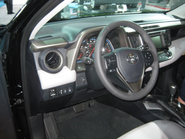 The 2013 RAV4's interior looks and feels upgraded. While there is still lots of cheap plastic, soft-touch and textured panels populate the areas you see/touch the most.