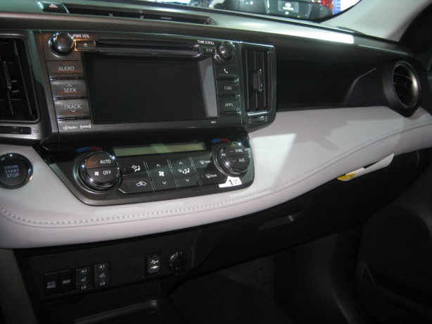 The RAV4's dash has many horizontal layers that I think work. The center controls are easy to reach and mix both hard knobs and buttons with some functions on the touch screen.