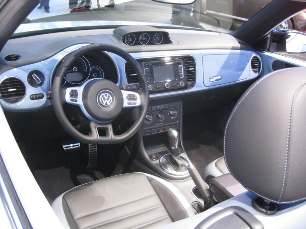 The interior of the 2013 VW Beetle Convertible is pretty much the same a the hardtop version. The color-matching interior parts is a nice touch.