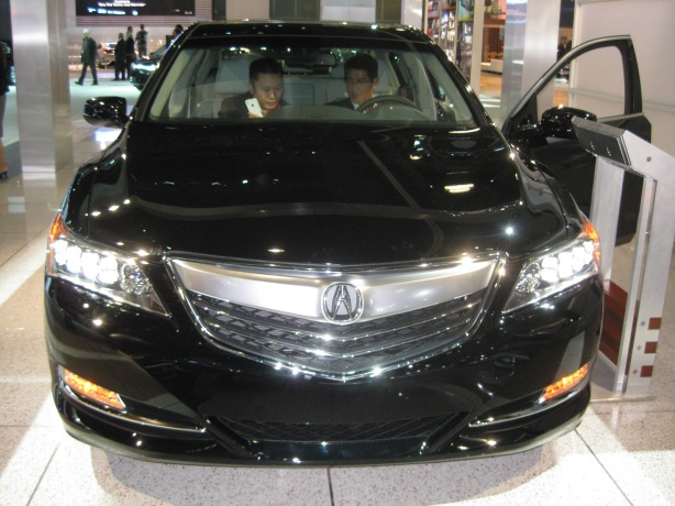 2014 Acura RLX with its blazing LED headlights.