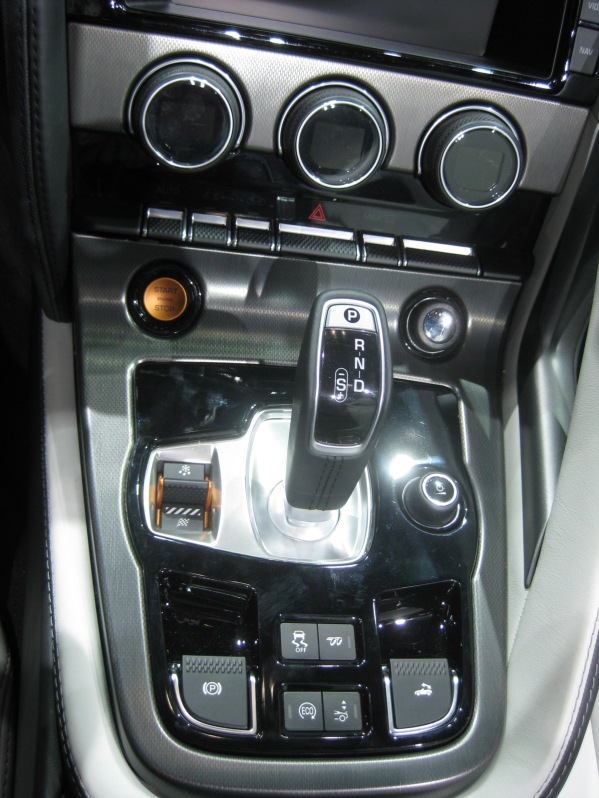 Center console of the 2014 Jaguar F-Type S. The shifter is very BMW and it uses the same ZF 8-speed automatic as the BMW. All good things.