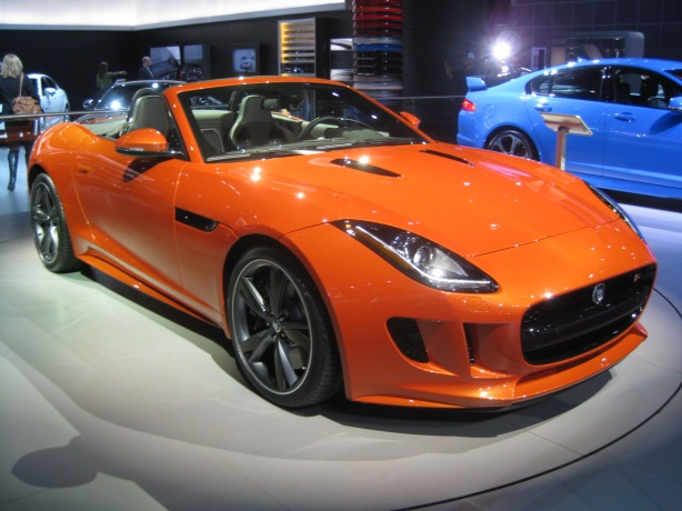 The very orange 2014 Jaguar F-Type V8S has a supercharged 5.0L V8 making 495 hp / 460 lb-ft torque. And damn, it looks GREAT in orange.