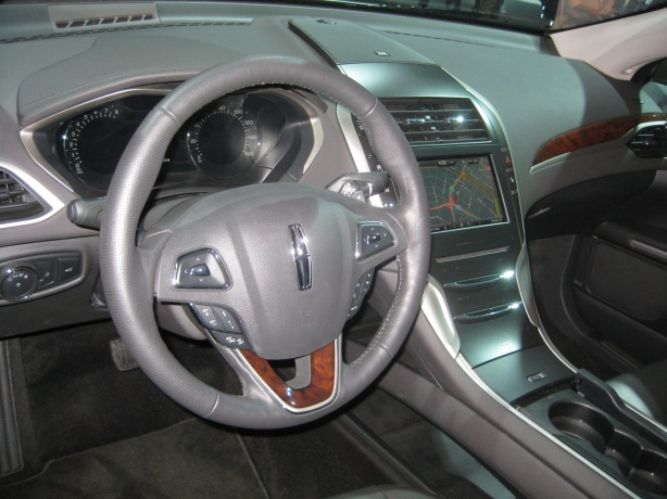 The interior of the Lincoln MKZ looks a bit too similar to the Ford Fusion except for one major change. The center console shifter is gone and the transmission is operated by electronic push-buttons on the upper left portion of the center dash. I'd rather have the floor shifter.