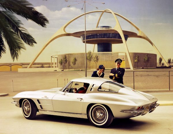 The mid-century icon, a 1963 Chevrolet Corvette Sting Ray Coupe in front of a Mid-Century modernist architecture masterpiece, the 1961 Theme Building at Los Angeles International Airport (LAX).