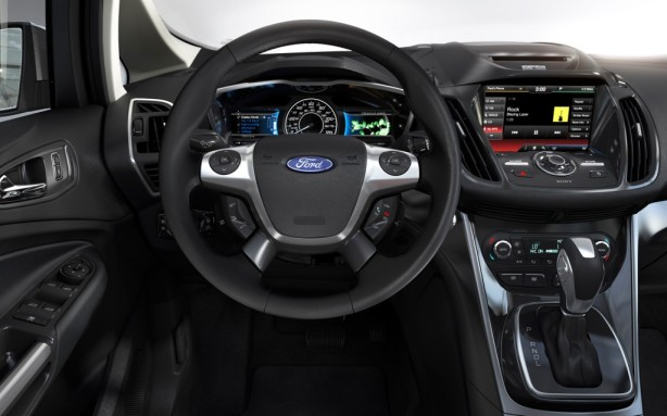 The cockpit of the 2013 Ford C-Max Hybrid. It bears more than a passing resemblance to the Ford Focus, which serves as the basis for the C-Max.