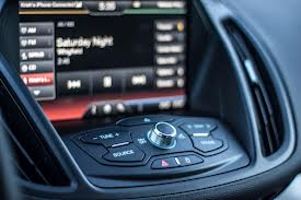 The 8 inch touch screen of MyFord Touch is deeply inset into the dash. Note the hard shortcut buttons and volume control in front of the screen.