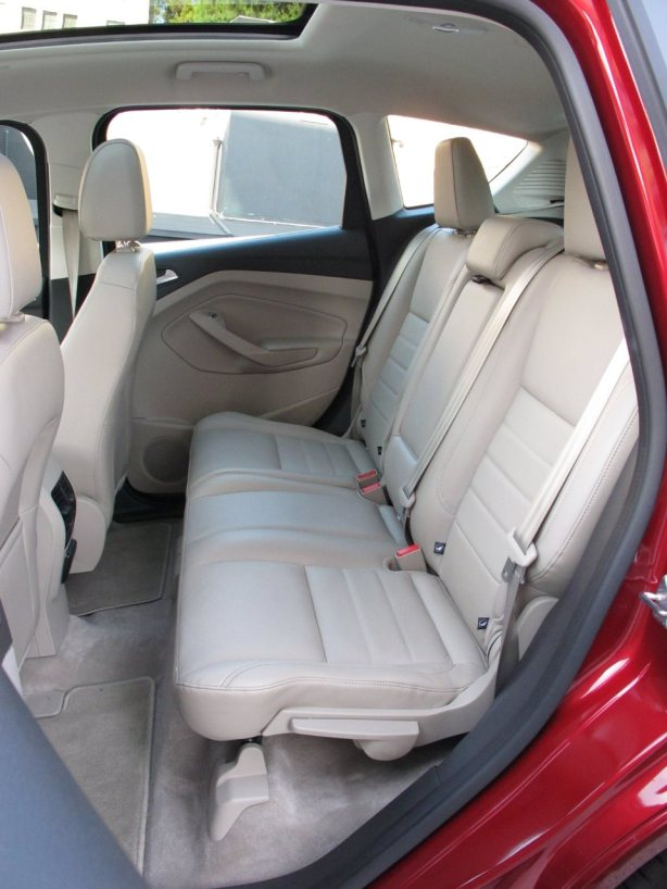 The rear seats of the C-Max split 60/40 and fold flat. Not much leg room for adults, but it's pretty easy to reach in to grab the kids.