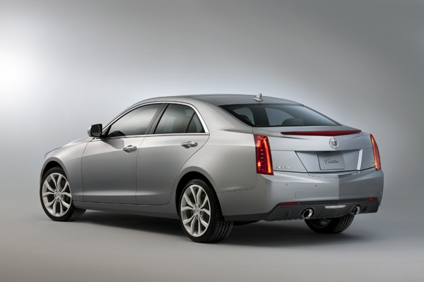 The rear of the 2013 Cadillac ATS. You can still see vestiges of fins in the vertical taillights and the center brake light is nicely integrated into the trunk spoiler.
