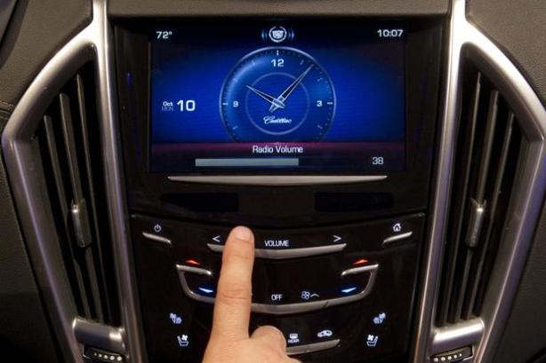 The capacitive sensing touch screen of CUE.