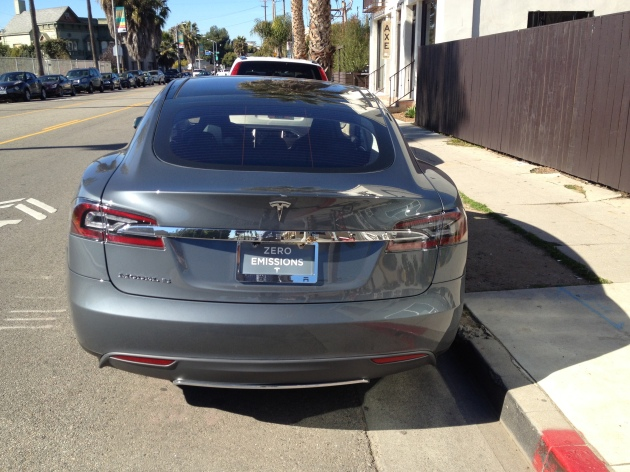 Another new Tesla Model S is able to find a coveted street parking space on Abbot Kinney in Venice.