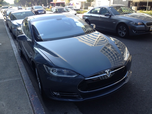 A new 2013 Tesla Model S enjoys Doris Day parking at BOA Steakhouse in West Hollywood.