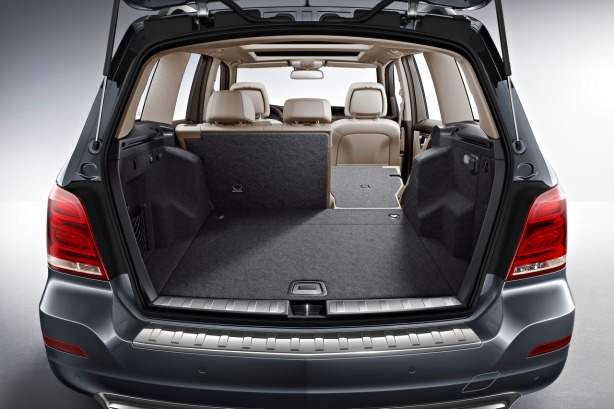 The 60/40 split rear seats fold flat in the GLK. There isn't a ton of space, but it's all well tailored and properly flocked.