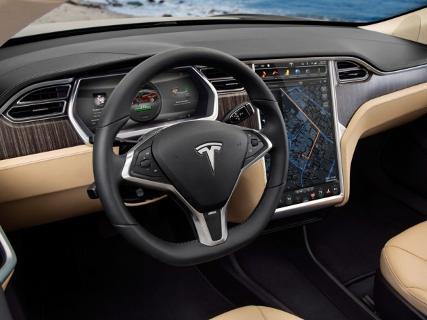 The interior of the Model S is a study in simplicity. The instrument panel is a large TFT video display and the gargantuan 17 inch center console tablet controls almost all the functions without physical knobs. Usually I like physical knobs, but in the Tesla, it's iPad-like touchscreen interface proves it can be done and done well.