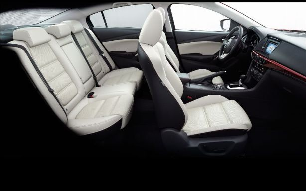 "This is the ""Almond"" interior. It looks off-white in person and while I like it, I think it would show dirt quickly."