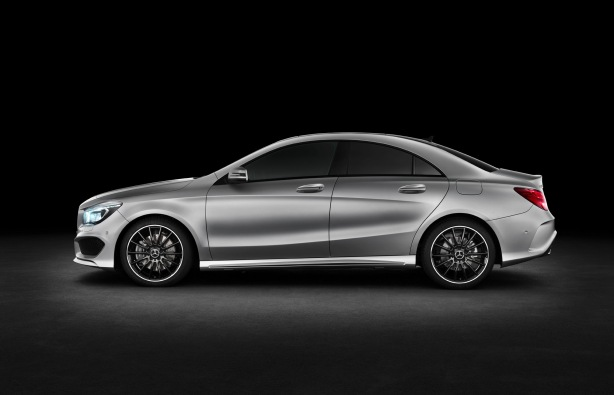 Side view of the 2014 CLA250 with the AMG styling package and upgraded wheels. The flowing lines eliminate the feeling of slab sides common in many cars.  The roof is steeply raked to give the coupe-like effect.