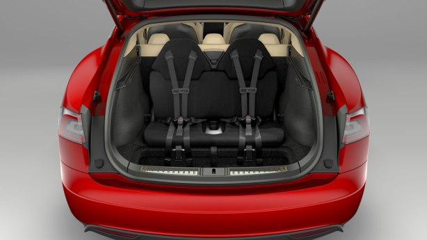 The cavernous rear compartment with optional rear-facing child seats. They fold flat into the floor.