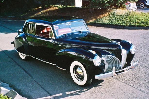 "This 1941 Lincoln Continental Coupe first displayed the ""eagle's wing"" used as inspiration for the modern face of Lincoln.   Barrett-Jackson auction picture."