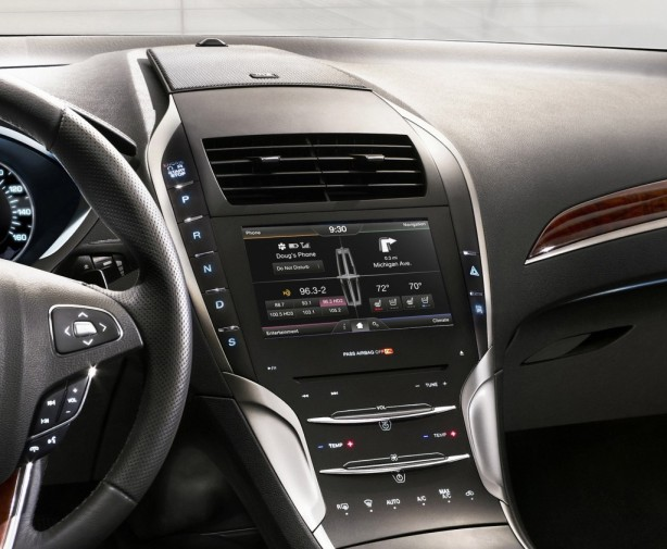 The infotainment and controls of the center stack are framed by the push-button transmission along the left side.