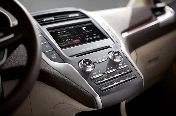 The latest-generation MyLincoln Touch system sees the return of round knobs and physical buttons to replace the touch controls found in the MKZ.  It's unclear if the 2015 MKZ will adopt these changes, but it's likely.