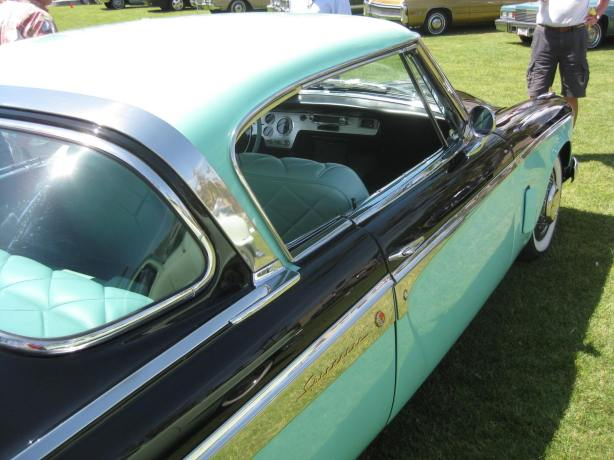 The turquoise and black color scheme of the Studebaker Hawk is wild.