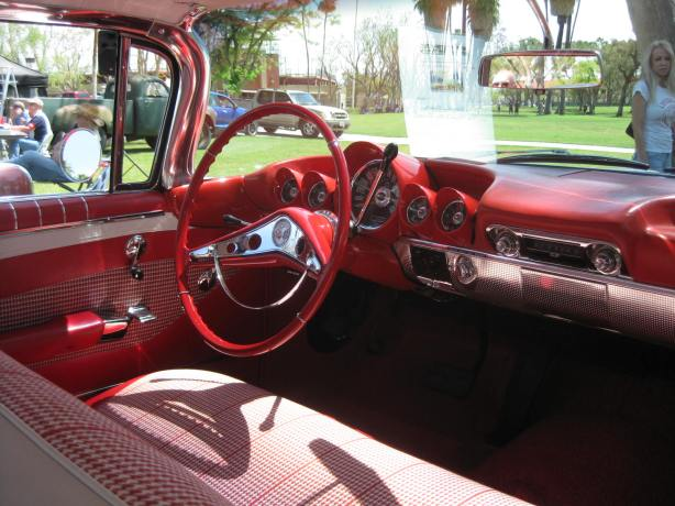 You just don't see interiors like this anymore. Everything matches the exterior color. Check out cast steel gauge cluster. You don't want to hit your head on this! Hard to find hounds-tooth fabric in a car anymore.