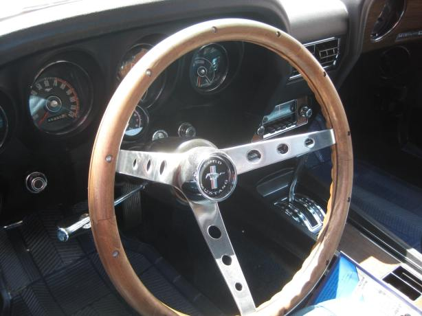 The aftermarket wood steering wheel looks period-appropriate in the 1969 Mustang GT. Some will lament that it has a 3-speed automatic transmission, but it makes for a great cruiser.
