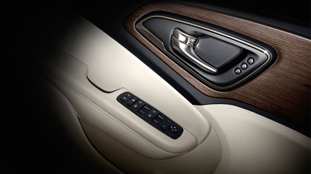 This is a detail of the interior door trim/pull handle. The memory power seats are an upgrade to the top-of-the-line 200C.  The simulated open pore wood trim is nicely done.