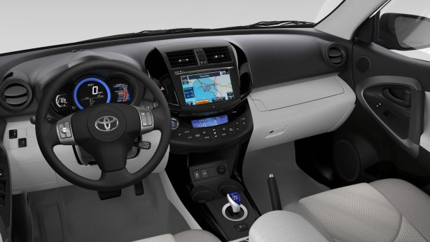 The instrument panel, center stack and electronic shifter are all unique to the RAV4 EV. The rest is pure stock, cheap, RAV4.