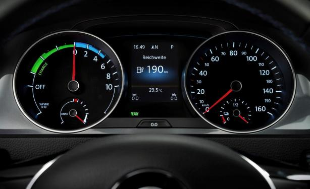 The instrument panel of the e-Golf looks nearly the same as the standard Golf except the analog gauges show the battery charge rather than fuel.