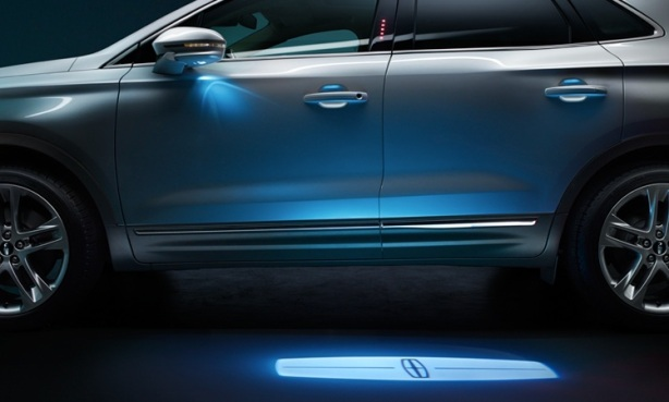 "LEDs bathe the exterior in soft accent lighting. You've gotta love the puddle light that projects the ""LINCOLN"" on the ground."